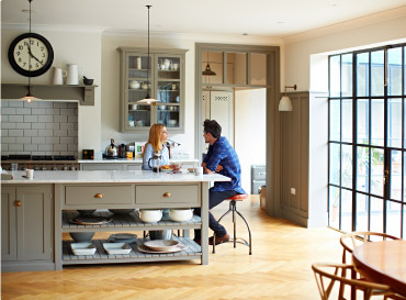 Couple sitting at kitchen counter
