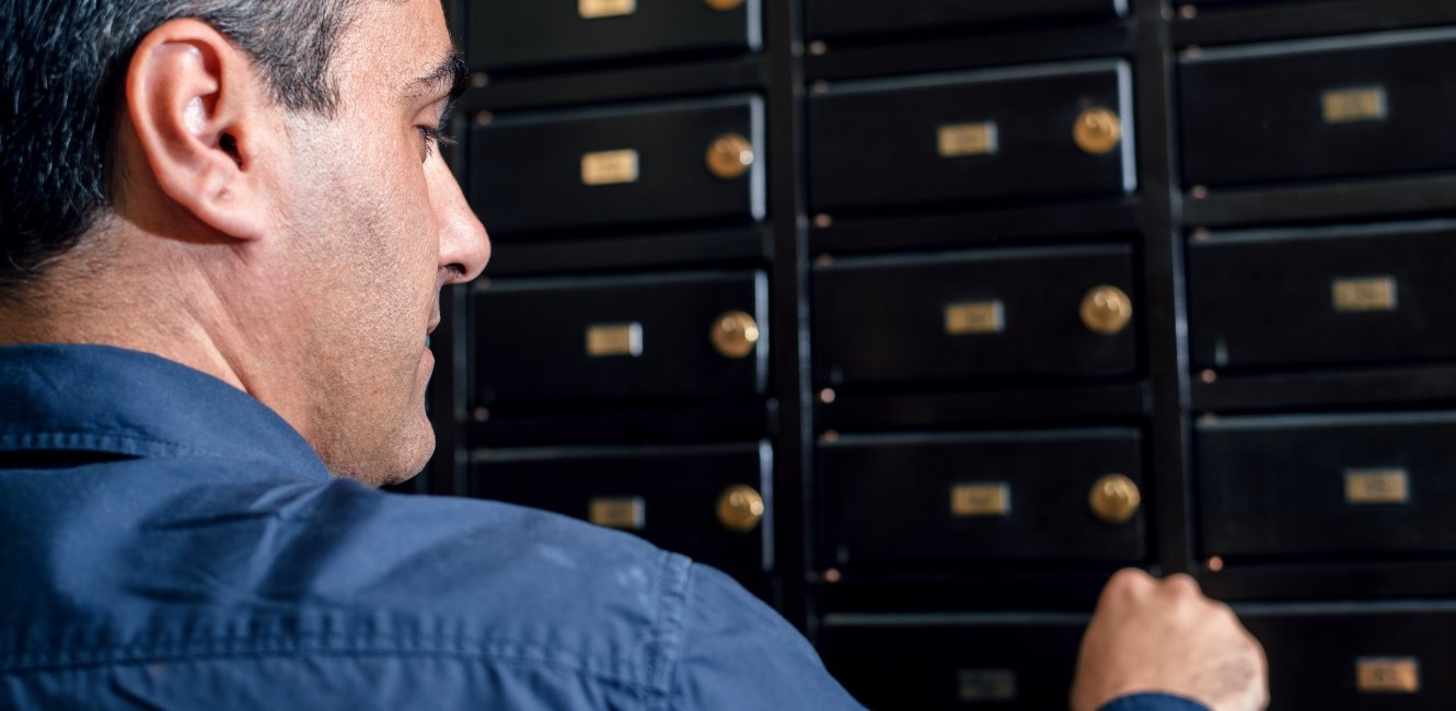 Man opening safe deposit box